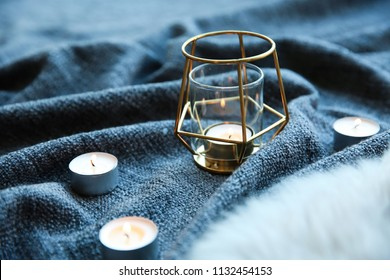 Beautiful burning candles on fabric. Time to relax