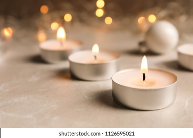 Beautiful burning wax candle on table, closeup
