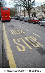 beautiful bus stop sign with red british typical transportation in Cheltenham?s promenade, England