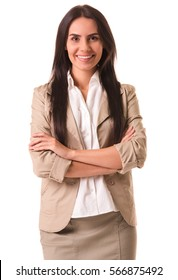 Beautiful business lady in beige suit is standing with crossed arms, looking at camera and smiling, isolated on white