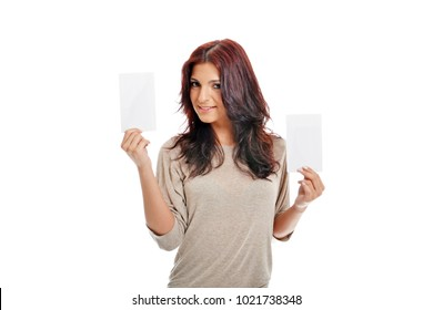 Beautiful business lady showing two big empty cards