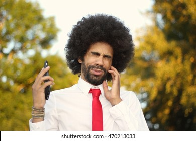 Beautiful business man with an afro outside