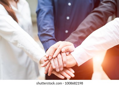 Beautiful business people holding hands together while working teamwork, success  concept