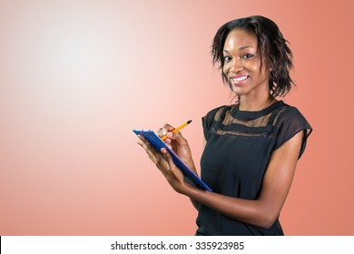 Beautiful business professional, african woman making notes