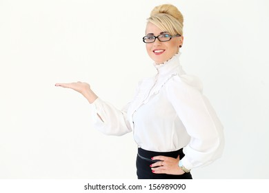 Beautiful business woman with blonde hair and glasses who is showing something with her hand