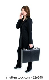 Beautiful business woman with briefcase speaking on cellphone. Full body over white.