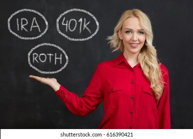 Beautiful business woman with chalk on a chalkboard with word retirement, ira, 401K, roth 