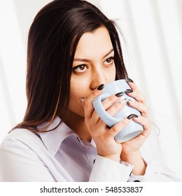 Beautiful business woman enjoying in a cup of coffee