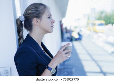 Beautiful business woman enjoying in a cup of coffee (drink, activity, taste)