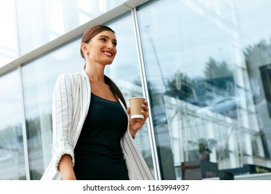 Beautiful Business Woman Going To Work Near Office Building