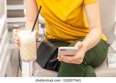 beautiful business woman hands with mobile phone and coffee