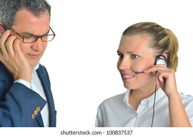 Beautiful business woman with headset and talking to a businessman