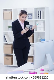 Beautiful business woman hearing good news on her cell phone,small depth of field