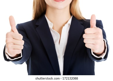 Beautiful business woman with her thumb up, showing oK. Body part, over white background.