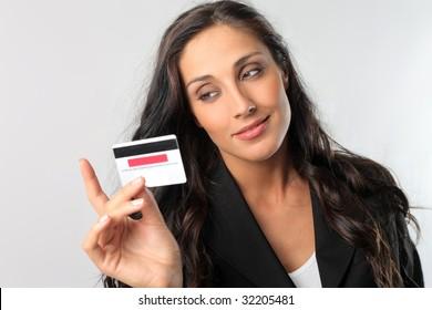 beautiful business woman holding credit card