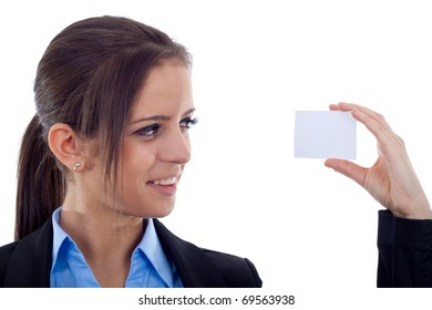 Beautiful business woman holding and looking at a blank card