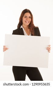 Beautiful business woman holds blank banner isolated over white background