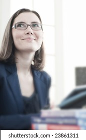 Beautiful business woman at office place