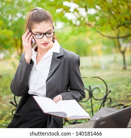 Beautiful business woman outdoors