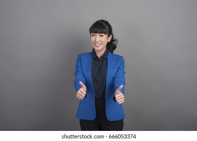 Beautiful Business Woman smiling on grey background
