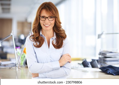 Beautiful business woman standing at office.