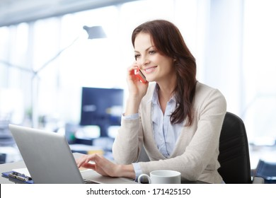 Beautiful business woman talking on mobile phone