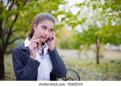 Beautiful business woman talking on cellular telephone outdoors