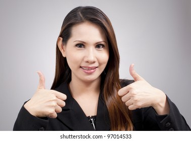 beautiful business woman with thumbs up in smiling expression