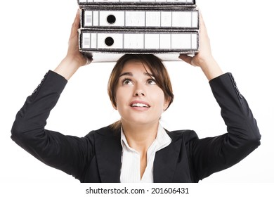 Beautiful business woman tired of work and carrying lots of folders on hands, isolated over white background