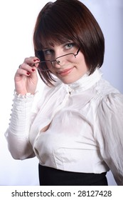 Beautiful business woman touching her glasses with hand