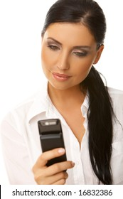 Beautiful business woman is using mobile telephone