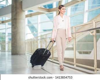 Beautiful business woman is walking in Airport , Business travel concept