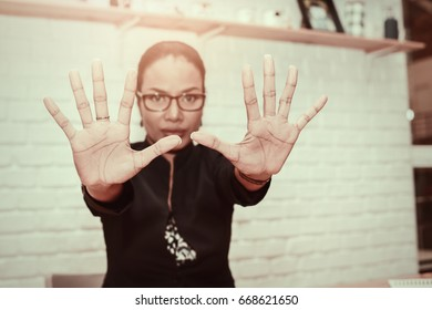 Beautiful Business woman wearing black suit showing her hands to camera.Touch screen business futuristic concept, hand push interface, design template