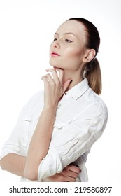 Beautiful business woman in a white shirt, hair in a ponytail on a white background