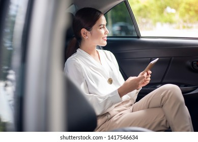 Beautiful business woman is working in car