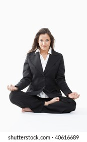 beautiful businesswoman in black suit exercising yoga - clipping path