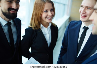 Beautiful businesswoman discussing a project with her male colleagues