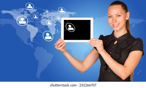 Beautiful businesswoman in dress smiling and holding tablet pc. Network with people icons and world map as backdrop