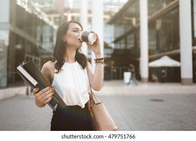 Beautiful businesswoman drinking coffee