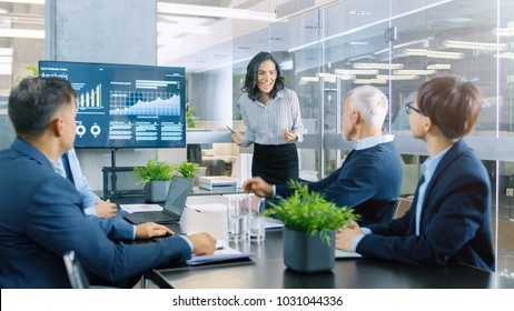 Beautiful Businesswoman Gives Report/ Presentation to Her Business Partners Everybody Cheer and Applaud and Give High Five Approving Her Project.