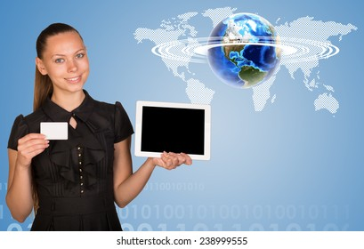 Beautiful businesswoman holding blank tablet PC and blank business card. World map, figures and globe surrounded by horisontal rings as backdrop. Elements of this image furnished by NASA