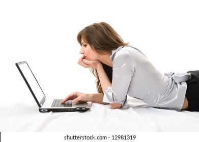 Beautiful businesswoman with a laptop working. Over white background