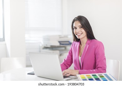 beautiful businesswoman at office in front her laptop