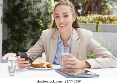Beautiful businesswoman on her lunch outside at the coffee shop