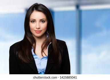 Beautiful businesswoman portrait in a bright office