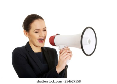 Beautiful businesswoman screaming through megaphone.