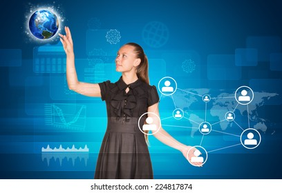 Beautiful businesswoman in suit pointing finger on network with people icons and Earth. Graphs in background. Elements of this image furnished by NASA
