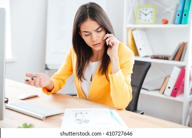 Beautiful businesswoman talking on the phone in office