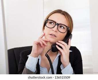 Beautiful Businesswoman Talking On Telephone In Office