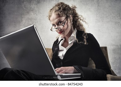 Beautiful businesswoman using a laptop